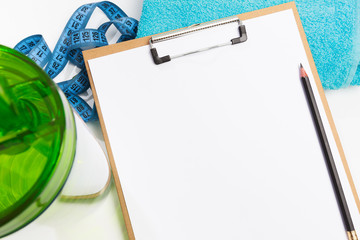Healthy eating plan, diet or fitness planning, blank white paper on clipboard with measuring tape on white  background, writing message to set target or goal, menu or message. - Image