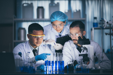 Health care researchers working in life science laboratory Wall mural
