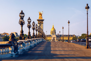 Pont Alexandre III bridge over river Seine in the sunny summer morning. Bridge decorated with ornate Art Nouveau lamps and sculptures. The Alexander III Bridge across Seine river in Paris, France. Wall mural