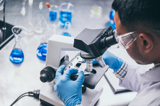 Health care researchers working in life science laboratory, medical science technology research work for test a vaccine, coronavirus covid-19 vaccine protection cure treatment