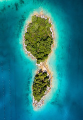 Printed roller blinds Island Aerial view on islands on sea. Seascape from air on the summer time. Azure water and islands with forest. Travel - image
