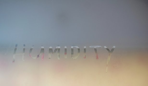 Window full of moisture with the word humidity written on it