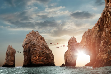 Photo sur Aluminium Taupe Rocky formations on a sunset background. Famous arches of Los Cabos. Mexico. Baja California Sur.