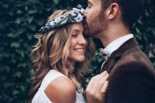 Beautiful wedding couple kissing sweet