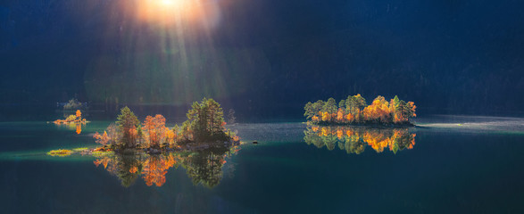 Fototapeten Blaue Nacht Charming autumn landscape of islands with pine-trees in the middle of Eibsee lake.