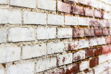 Dirty white and brown brick wall perspective