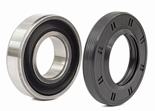 Ball bearing and oil seal for machine repair, isolated on white background