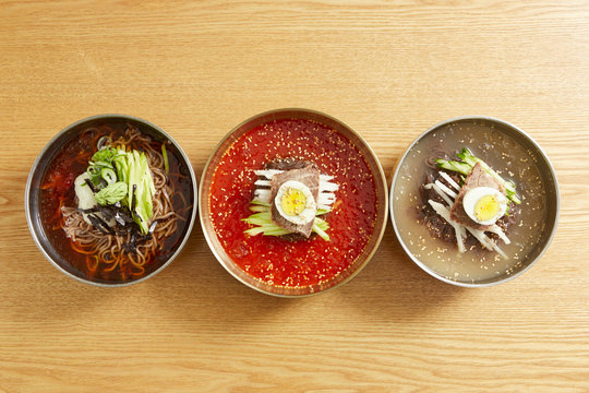Various Korean cold noodles on table