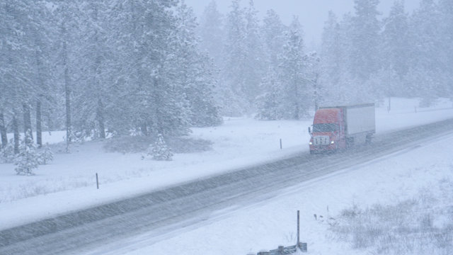 Truck hauls a container across the state of Washington and through a snowstorm.