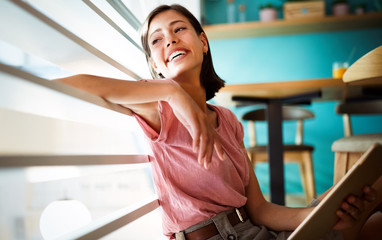 Beautiful young happy cheerful woman enjoying her time and freedom Fotobehang