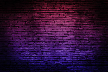 Neon light on brick walls that are not plastered background and texture. Lighting effect red and...