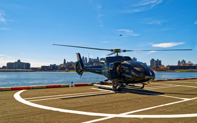 Helicopter landing at helipad. Skyline with Skyscrapers in Brooklyn Manhattan, New York City, America USA. American architecture building. Metropolis NYC. Cityscape. Hudson, East River NY