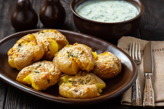 Crispy smashed potatoes roasted with garlic and parmesan.