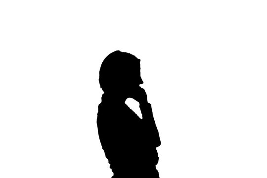 Silhouette of person talking on a cell phone