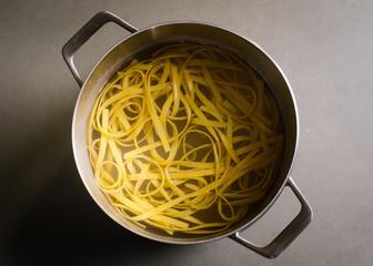 Overhead view of pasta in hot water
