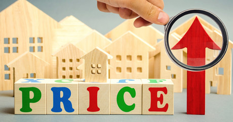 Wooden blocks with the word Price, up arrow and wooden houses. The concept of raising property prices. High cost for rental housing and real estate. Expensive loans to buy an apartment. Analytics