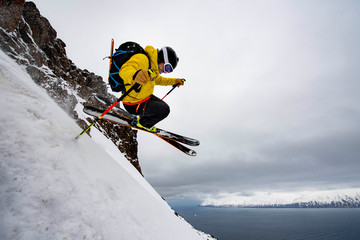 A man backcountry skiing to the ocean at in Iceland.