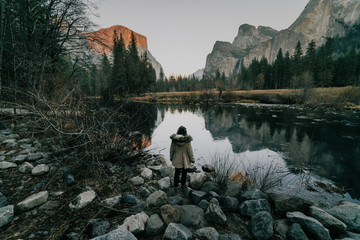 Female tourist in Yosemite looking at river against mountains