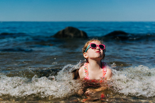 A little girl swims in the Long Island Sound.