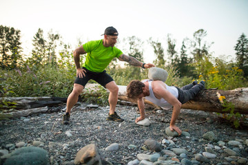 Personal trainer uses boulders to push a client toward goals.