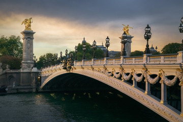 Foto op Aluminium Historisch mon. Pont Alexandre III with Petit Palais in the background at sunset