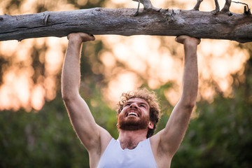 Man shows painful emotion during an outdoor workout.