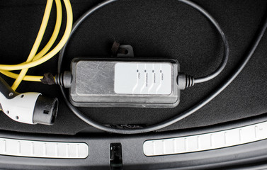 electric car lead in the trunk of a car