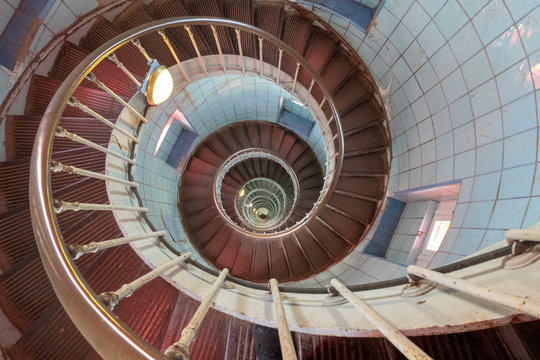spiral staircase leading to a lighthouse