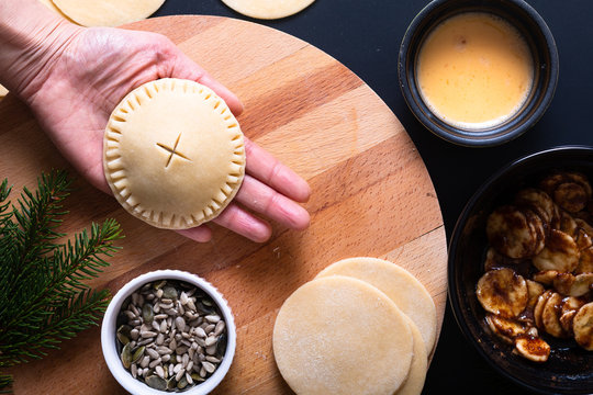 Food concept processing to make Homemade Banana foster hand pie on black background