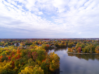 Aerial view taken with a drone of an autumn landscape with river