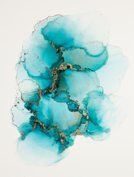 Beautiful ethereal teal ink painting with gold accents isolated on white background