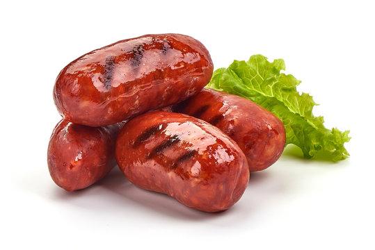 Grilled Spanish chorizo sausages, isolated on white background