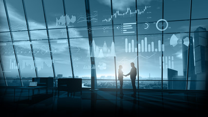 Business handshake in office on a background of infographics.