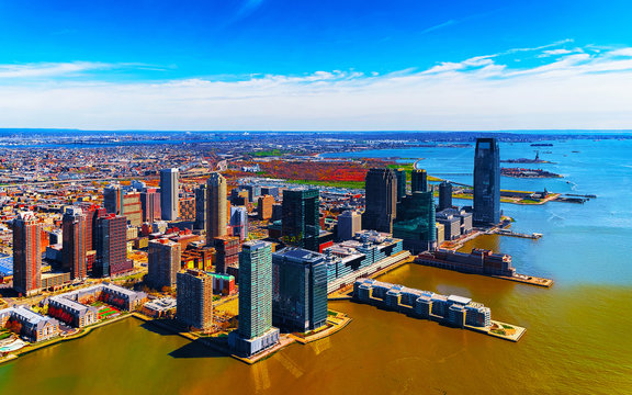 Jersey City, New Jersey and Hudson River. View from Manhattan, New York of USA. Skyline and cityscape with skyscrapers at United States of America, NYC, US. Road and American architecture.