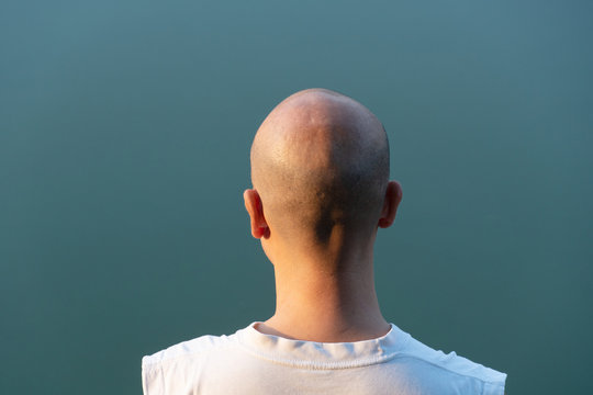 behind  portrait of 40s bald Asia man head with blue background