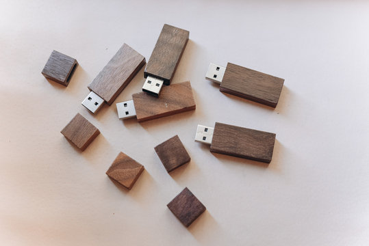 A wooden usb flash memory drive made from dark wood.