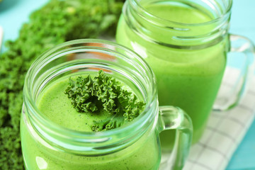 Tasty fresh kale smoothie on table, closeup