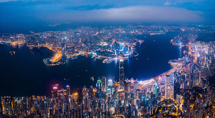 Wall Mural - Amazing night aerial view of cityscape of Victoria Harbour, center of Hong Kong