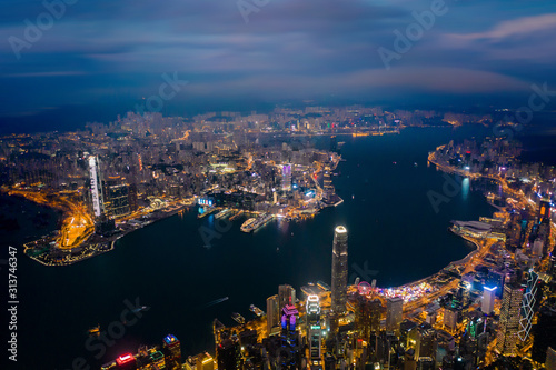 Wall mural Amazing night aerial view of cityscape of Victoria Harbour, center of Hong Kong