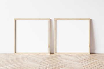 Two square wooden frame mockup. Set of Two mock up poster on wooden floor. 2 square frame 3d illustrations. Wall mural