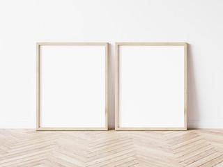Two vertical wooden frame mockup. Two mock up poster on wooden floor. 2 frame 3d illustrations.