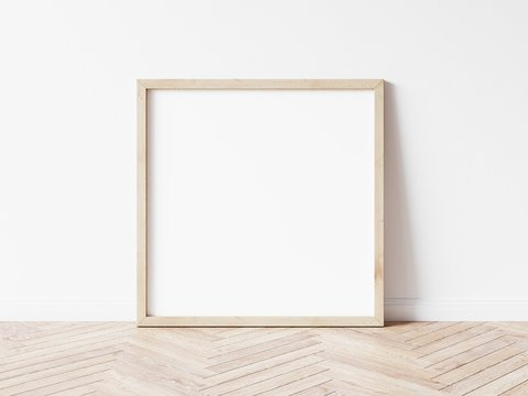 Square wood frame mockup. Wooden frame on wooden floor. Square frame 3d illustrations.
