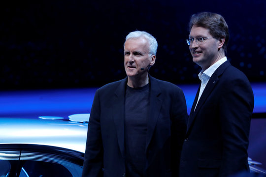 Director James Cameron (L) and Ola Kallenius, chairman of the board of Daimler AG and Mercedes-Benz AG, pose after the unveiling of the Mercedes-Benz Vision AVTR concept car during the 2020 CES in Las Vegas