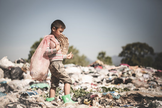 Poor children collect garbage for sale.and recycle them in landfills, the lives and lifestyles of the poor, Child labor, Poverty and Environment Concepts
