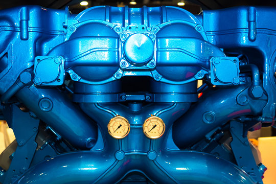 Engineering. The engine from the ship. Shipbuilding. Production of engines for boats. Engine of a marine vessel. Motor ship close up. Maintenance of motor yachts. Mover of the ship close-up.