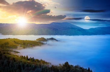 time change concept with sun and moon above mountainous countryside. valley full of rising fog. green foliage on trees. wonderful nature scenery in springtime