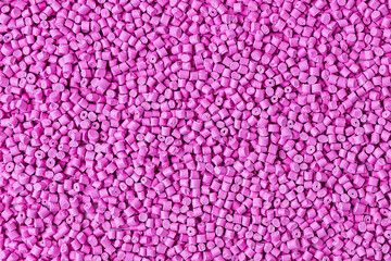 Background of plastic granules. Abstract background color pink