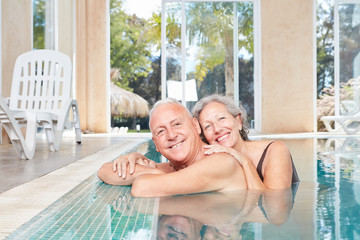 Smiling seniors couple in the swimming pool