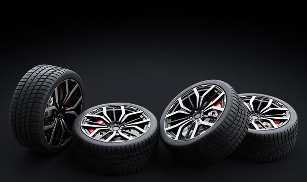 Set of wheels with modern alu rims on black background
