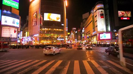 Fototapete - Motion video of Shibuya Crossing, Tokyo. The scramble crosswalk is one of the largest in the world.